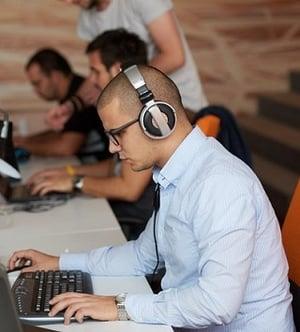 Man working at laptop for internal communication